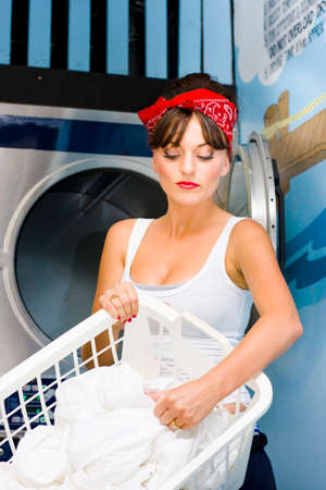 sexy housewife: Woman Sorts Her House Bed Sheets and Clothing In Front Of A Front Loading Washing Machine At The Local Laundry Mat While In The Process Of Washing Clothes