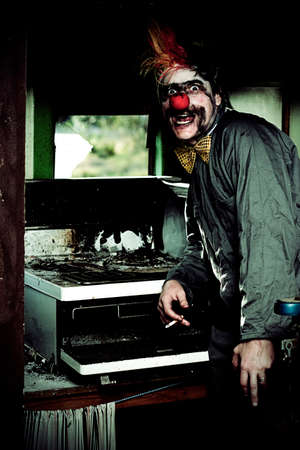 mr: Mr Bungle The Kitchen Clown Stands Next To A Burnt Out Kitchen Stove In A Humorous Display Of Bad Cooking