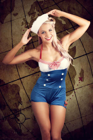pin up: Vintage Grunge Photo Of A Young Woman In Sailor Hat And Pinup Outfit Standing In Front Of An Old Travel Map Illustration