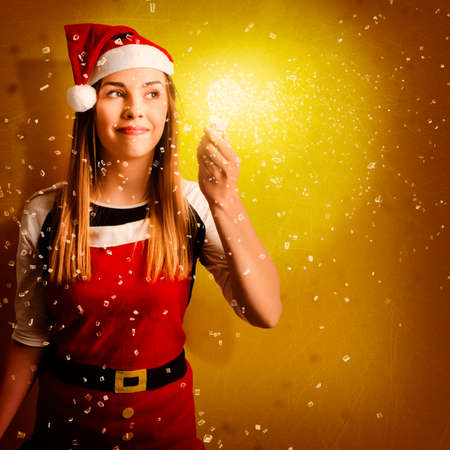 shards: Creative portrait of a little santa helper girl holding shattering light bulb with bright shards of imagination and inspiration. Explosive christmas gift idea