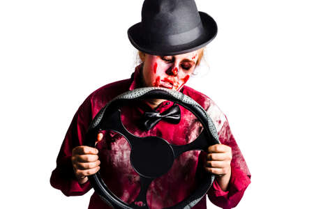 bloodied: Tired sleeping dead woman holding a vehicle steering wheel. Driver fatigue concept