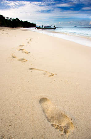 silhouetted: Footprints On Sandy Tropical Beach With Silhouetted Boat In Background, Phi Phi Island Thailand