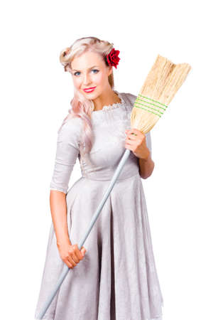 housemaid: Attractive young blond housemaid in dress with retro style broom, white background
