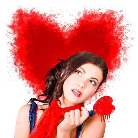 romantic woman: Photo of romantic woman holding love candy, looking up to heart shape illustration background. Bleeding heart