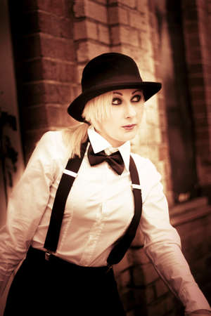 traditionalist: Portrait Of A Beautiful Blond Woman Strutting Her Old Fashioned Style On A Old-Fashioned Street Corner Stock Photo