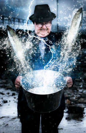 tubby: Art Photo Of A Lightning Bolt Hitting A Bucket Filled With Water And Fish Held By A Business Man In Suit And Tie In A Lucky Strike Conceptual Stock Photo