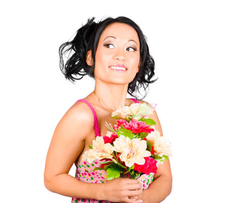 accepting: Isolated image of a beautiful Asian girl accepting a colourful bunch of flowers. Nature love Stock Photo
