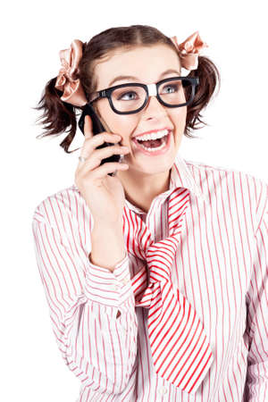 dweeb: Laughing fun nerd woman or student wearing pigtails and dork eye glasses chatting on a smartphone isolated on white