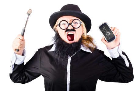 expiring: Angry woman smashing up smartphone with hammer when breaking her mobile phone contract Stock Photo