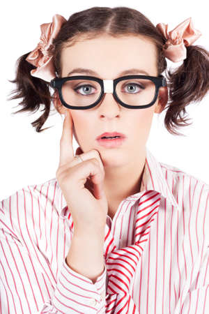 puzzling: Nerdy Young Woman In Pigtails And Heavy Rimmed Glasses Looking At The Camera With A Look Of Enlightenment As She Suddenly Makes A Mental Breakthrough In A Puzzling Problem