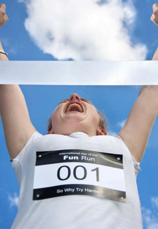 1st place: Marathon Runner Celebrates An Arms Up Victory While Crossing 1st Place At The Finsh Line