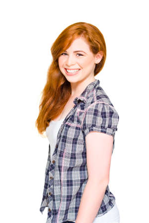 fair hair: Education Concept With A Cute Happy Female University Student With Red Hair Smiling Next To Blank Text Copy Space In A Isolated Studio Portrait Stock Photo