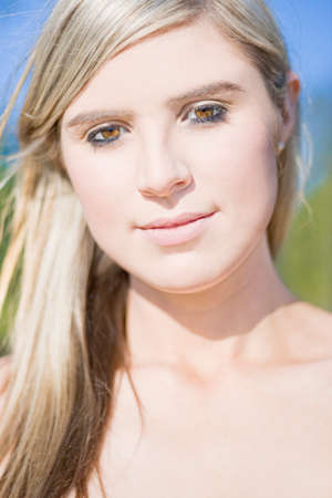 dazzled: Close Up Portrait On The Face Of A Smiling Beautiful Woman Outdoors Stock Photo