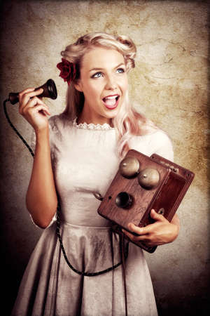 switchboard: Shocked Young Woman Holding Old Wooden Box Phone While Working As A Telephone Operator In A Good News Or Bad News Concept