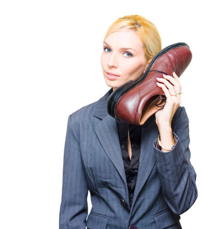 operative: Undercover Spy Or Secret Agent Detective In Business Suit Holds Up A Large Shoe Telephone When Communicating As A Comical Clandestine Operative Of Espionage