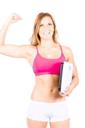 reduce: Excited Weight Loss Woman Holding Bathroom Measuring Scales While Winning The Battle Of The Bulge Over White Background Stock Photo