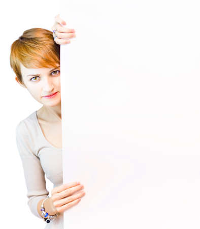 room for your text: Beautiful Attractive Young Woman With Red Hair Holding A Blank Copyspace White Board With Room For Your Text Or Message, Isolated On White Background Stock Photo