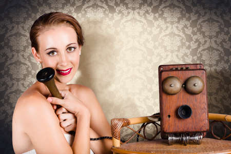 daydreaming: Attractive young romantic woman daydreaming with old fashioned operator phone