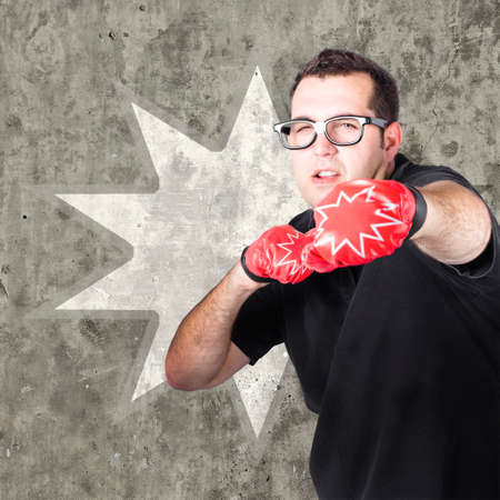punched out: Regular guy punching and working up a sweat with boxing gloves on during a bootcamp fitness workout. Pow background