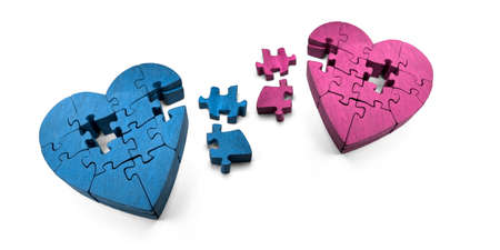 love hurts: Wooden Jigsaw Hearts In Pieces, The Scattered Puzzle Of A Broken Romance