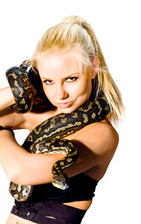 slither: Danger, Caution And Concern Slither Along A Gorgeous Blond Womans Arm While Holding A Python Snake, Studio Photo Isolated On White Background