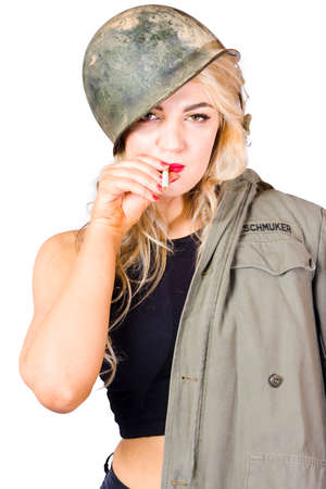audacious: White background picture of a tough and determined female soldier smoking cigarette with aggressive expression. Battle ready