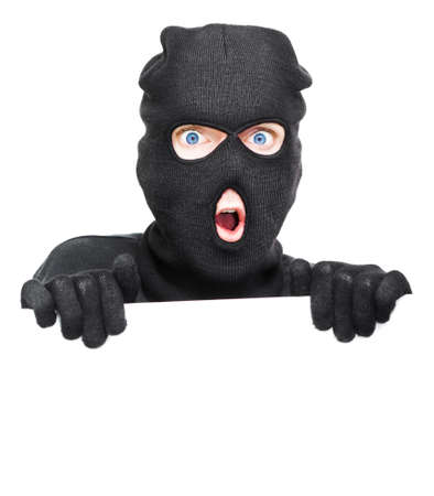 pickpocket: Surprised Robber Caught Holding A Blank White Board During A Break And Enter In A Home Security Copyspace Conceptual, Isolated On White Background