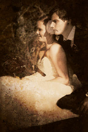 olden day: Sepia Tone Image Of Young Bride And Groom Sitting And Gazing Off Into The Distance As If It Is A Flash Of A Memory In The Distant Past