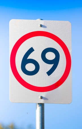 sex traffic: Road Speed Sign On Route Sixty Nine, 69 or Sixty-nine, The Highway Of Love And Sexual Pleasure Stock Photo