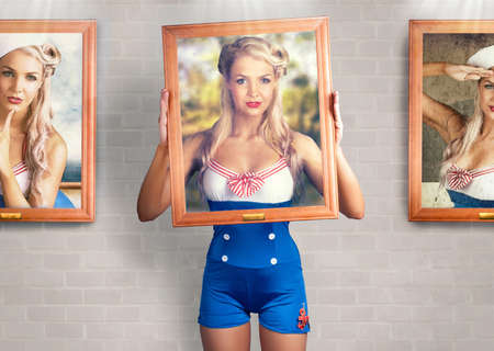 discovery: Good Looking Female Pin-Up Model Holding Old Wooden Frame Inside Fine Art Gallery When Displaying Modelling Photo Portfolio