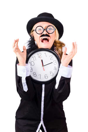 exclaiming: Crazy man with bowler hat fake mustache and beard holding large clock with hands up showing look of overdue despair