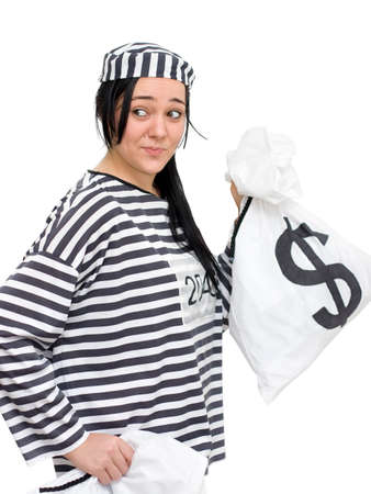 hilarity: A Case Of Cash And Carry As A Felon Looks Over Her Shoulder In The Process Of Penny Pinching Stock Photo