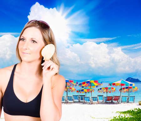 murmur: Young woman holding a shell to her ear in black bikini
