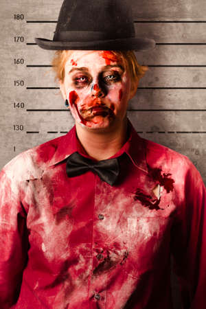 grisly: Police criminal mug shot of a female monster with busted up face standing on height record chart. Bleeding guilty