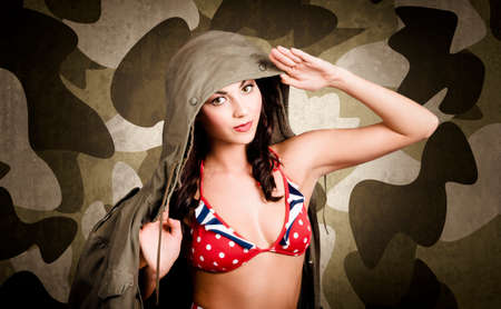 army girl: Sexy vintage army girl saluting in general class on army green camo background