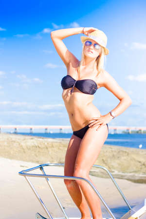sightseeing tour: Female Tropical Beach Traveling Tourist On Sightseeing Tour While On Ocean Vacation Standing On A Speed Boat Or Ocean Cruiser, Holiday Travelling Concept Stock Photo