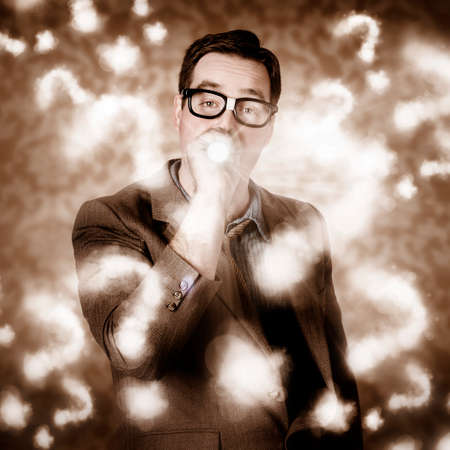 seeking an answer: Creative design photograph of a businessman thinking with search light in a cloudy haze of question marks. Problem solving Stock Photo