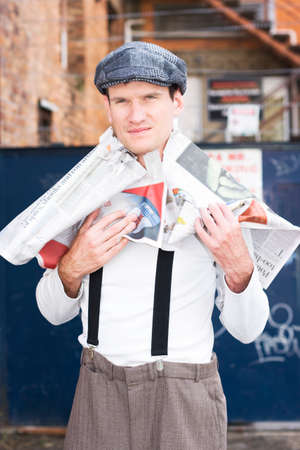 wearer: Over His Head In The Latest Fashion News A Fashionable Man Wears A Newspaper As A Victim Of Fashion
