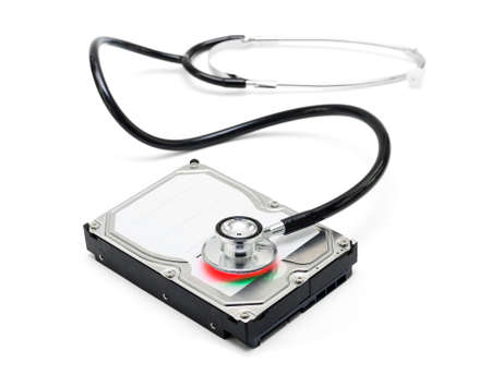 aftersales: Depiction of computer repairs and digital data recovery with a stethoscope scanning for lost information on a hard drive disc isolated on white background