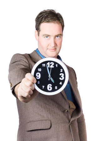 elapsed: Mature Businessman Showing Time In Front Of Camera