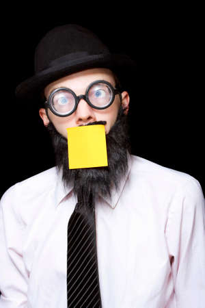 notelet: Mad Scientist Wearing Funny Glasses And Bowler Hat Looking Stressed With Copyspace Sticky Note On Face