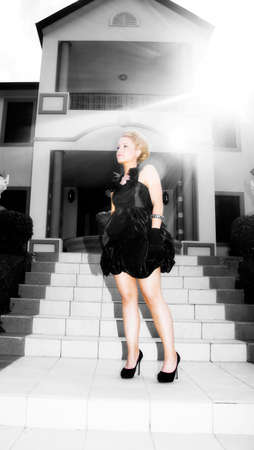starlet: Lights Of Glamour Shine Upon A Female Starlet Standing On A Staircase Looking Stunning Whiling Modelling A Black Dress