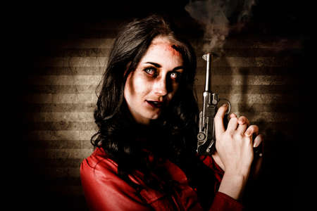 undead: Undead female zombie glaring at you while holding a smoking gun in a kill or be killed concept on striped interior background
