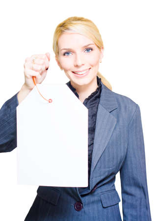 sales clerk: Happy Smiling Female Shopping Store Sales Clerk Holding Up A Discount Specials Blank Price Tag In A Consumer Sale Marketing And Retail Image With Copyspace