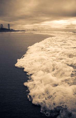 Stormy Gold Coast Beachfront With Dramatic Waves Rushing To Shore, Taken Burleigh Beach, Queensland, Australia Stock Photo