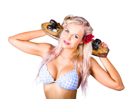 white back: Glamorous blond woman with rose in her hair  holding skateboard behind her head on white background Stock Photo