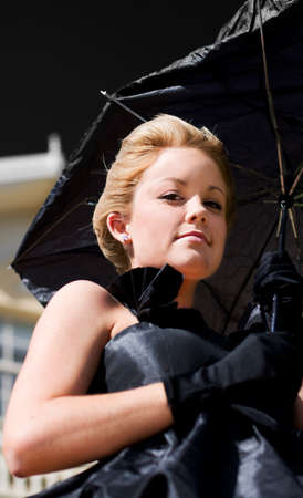 drab: A Sky Bound View Of A Female Holding A Broken Black Umbrella During Dark And Stormy Days