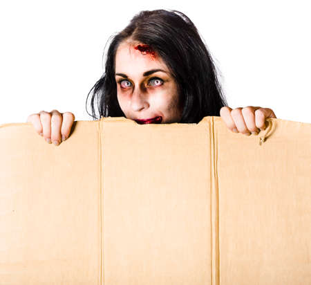 text box: Zombie woman with injuries peering out of cardboard box at Halloween with space for added text