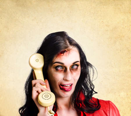 reanimated: Unreliable female zombie administration clerk handing over a telephone receiver late with a dead phone line