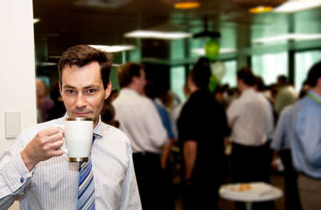 business networking: A Business Man Gets A Wake Me Up Coffee Hit During A Conference Morning Tea Break Stock Photo